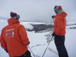 Ski School instructors looking over Scottish mountain slopes
