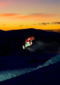 Snowboarding at night Glenshee Scotland
